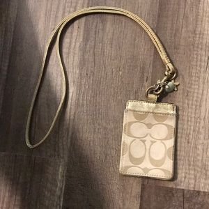 Coach gold lanyard id holder